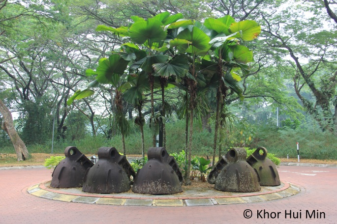 Dredge steel buckets used as decoration at a small roundabout in Clearwater Sanctuary, Perak.