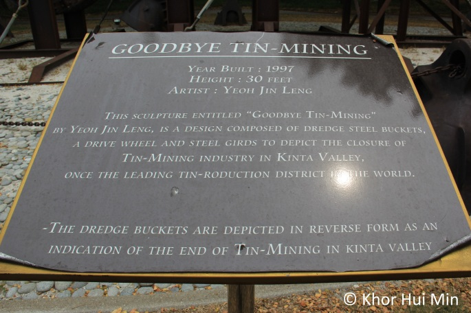 Plaque in front of a sculpture entitled 'Goodbye Tin-Mining'. The sculpture is located inside Clearwater Sanctuary, Perak.